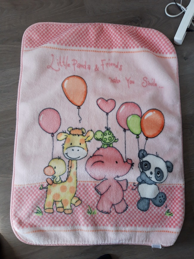 Couverture rose animaux