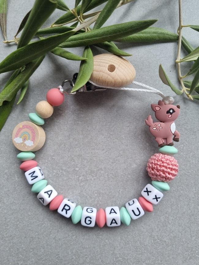 Attache tétine bébé  en perle silicone vert menthe et rose motif Arc en ciel et Biche
