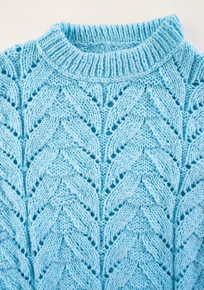 Pull tricot motif grandes torsades