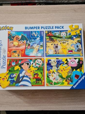 boîte de 4 puzzles de 100 pièces Pokemon