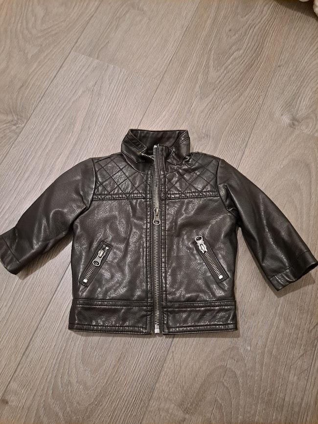 Manteau en cuir fourré