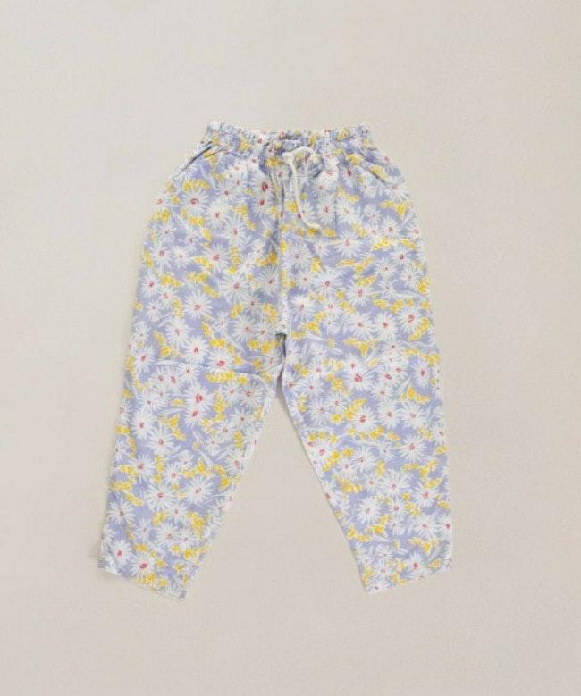 Pantalon lilas à fleurs blanches / 5 ans