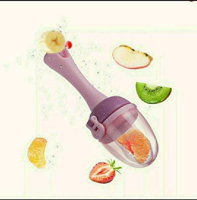 tetine alimentaire grignoteuse bébé pour fruits avec attache