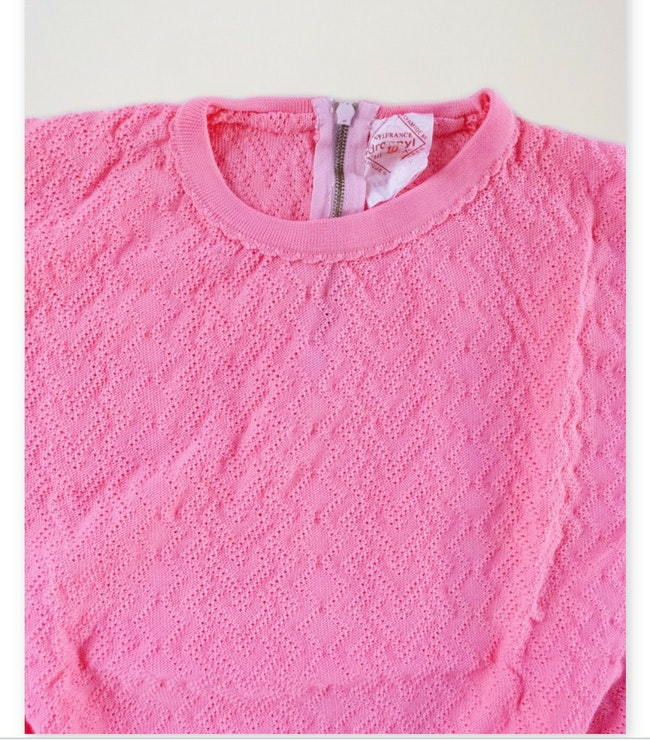 Petit pull rose bonbon motif ajouré / 5 ans